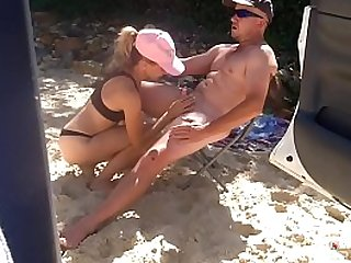 Beach babe sucks and fucks hard cock on the beach