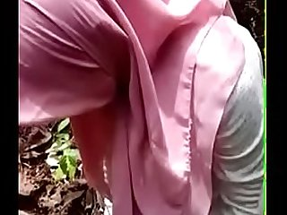 Malay Jilbab Girl Stripping in the Forest