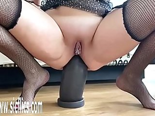 Slamming Her Ass on a Colossal Dildo