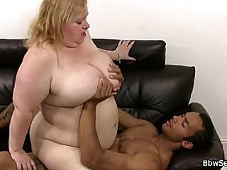 Busty plumper rides huge black cock