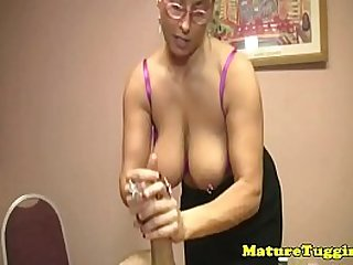 Busty mature tugging a younger mans cock