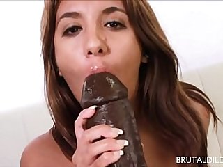 Chubby brunette Lola feeds her pussy a fat brown dildo