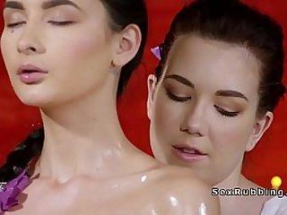 Pale masseuse fingering lesbian babe
